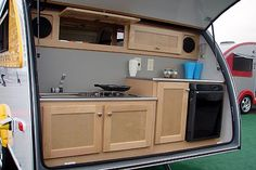 One of these campers lives down the road from us and I have been dying for a look inside.  Cooking out the back seems ideal and they pull it with their Subaru wagon!  Love that!