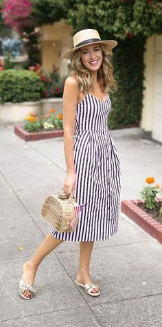 Navy and white striped spaghetti strap sun dress with bow tie back, boater hat + straw basket bag {mango, madewell, hinge, kayu, summer style, fourth of july style}