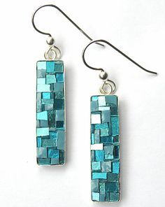 Detailed mosaic jewels created by renowned mosaic artist Margo Anton