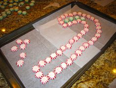 preheat oven @ 350' arrange mints on wax or parchment paper covered cookie sheet allowing extra room on the sides Bake for 8-10 minutes cool on cookie sheet about 5 minutes Remove wax paper from bottom - careful candy tray is fragile
