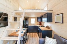 Tiny House Interior - Mansion by Uncharted Tiny Homes: Love the open feel, bathroom w/ open walk-in shower, washer/dryer combo in bath w/ storage, big windows to the sides of the loft & looks like enough space to sit up in loft, & french doors. No sunroof :(