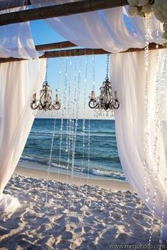 "Again with the whole ""magical beach wedding"" look. I love it, but I would hate to plan an elaborate beach wedding and end up getting rained out or have it be really windy or hot! Florida can be so unpredictable, especially in the spring! #beachweddings"