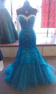 Love the color and where the gems are, but I would change it to a puffy skirt not a mermaid tail and add sleeves