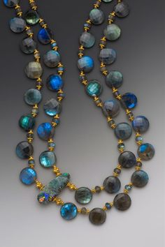 Two such stunning light-refracting stones come together once in a blue moon... an Australian boulder opal bead -- with blues, greens and more than a bit of fire -- provides the off-set focal point in this double strand necklace of large faceted brilliantly blue labradorite coin beads with lush 18K gold accents. (SOLD) #diva #oneofakind #necklace #jewelery #labradorite #boulderopal #statement #elleschroeder