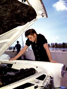 Elvis purchased a new '56 Lincoln Continental while on tour in Florida, August 4, 1956. Shown here checking under the hood.