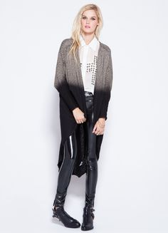 """Soft knit duster cocoon cardigan by Evil Twin. Cut long with a rounded open front, pleating at shoulders. Dip dyed effect from the chest down. Long dolman sleeves, pieced back. Relaxed fit.    100% acrylic cotton  30"""" length  Model is wearing size XS/S"""