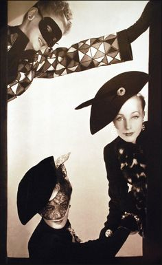 """Elsa Schiaparelli, spring 1939, Collection """"Commedia Dell'Arte"""", buttons and costume jewelry by Jean Schlumberger, photographed by Erwin Blumenfeld, Vogue US, December 1938"""