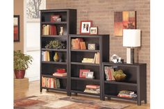 Tall, medium, and small black wooden bookcases to add to your living room furniture