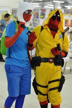 Two dudes cosplaying 2 superheroes cosplaying Adventure Time.