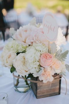 Blush colored rose and peony centerpieces in rustic boxes | Photographyby  Jake and Necia Photography, Florals by Adornments Flowers
