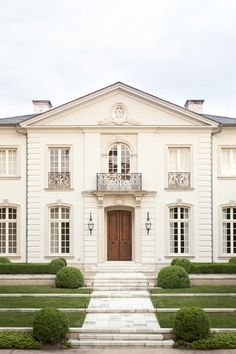 Front entry to a home in Atlanta by Howard Design Studio. Limestone & Boxwoods.