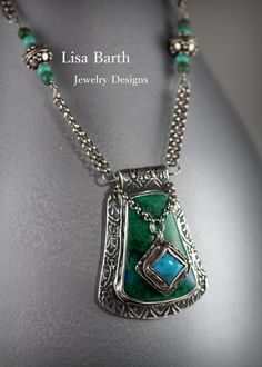 Here I made a pendant with a pendant.  ha ha  This was made with fine silver metal clay and bezel set Chrysocolla and turquoise. --Lisa Barth