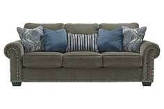 """The Navasota Queen Sofa Sleeper from Ashley Furniture HomeStore (AFHS.com). The """"Navasota-Charcoal"""" upholstery collection features a soft chenille upholstery fabric surrounding beautifully rolled arms adorned with nail head accents along with plush pillow back cushions to create the perfect Traditional Classic furniture to enhance any living room décor."""