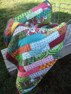 Easy quilt- love this, something to just throw on the couch and cuddle up with. Would probably do it in a mix of Amy Butler prints. Would also be cute and comfy in flannels.