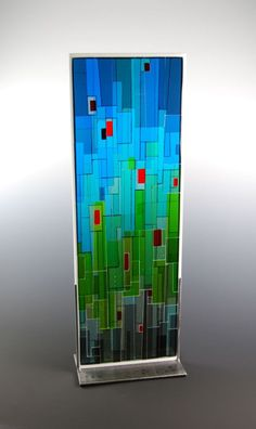Fused glass art by Morgan Madison. This is the one I had commissioned for us a few years ago.