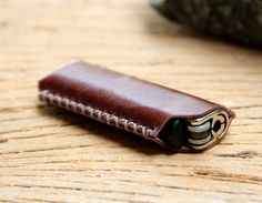 Brown leather lighter case. $9.00, via Etsy.