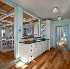 Pale blue kitchen walls and blue trim. Michigan lake cottage. J. Visser Design.