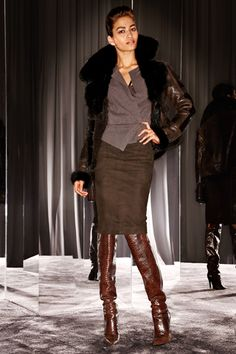 Tom Ford - very sexy outfit, love the fur-lined jacket and knee high snake skin boots.
