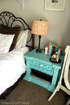 love the turquoise night stand!