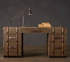 Had crafted by an antiques dealer and vintage furniture maker Timothy Oulton, oversized steamer trunk furniture and decorative accessories create luxurious and unusual rooms, filled with retro decor charm. Love this desk!