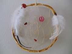 Peace Willow Dream Catcher assorted colors. $6.95, via Etsy.