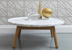This marble and wood table is by G&T , a new British furniture brand co-founded by Bethan Gray, who served as Habitat's head of furnitu. Carved Round Table, Table Design, Marble Furniture, Marble Top Coffee Table, Marble Interior, Marble Coffee Table, Coffee Table Wood, Coffee Table, Marble Table