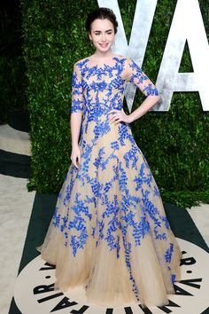Lilly Collins - this blushing young starlet looked beyond pretty in this Monique Lhuiller ball gown...  Modest, not too sexy for someone so young and the combination of this cerulean blue, latticed floral embroidery against the nude tulle makes my eyes very, very happy...