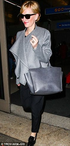 Cate Blanchett in a charcoal coat, Gucci handbag and black pants and flats