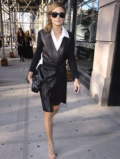 Olivia Palermo in a dark leather jacket and Aquazzura shoes.