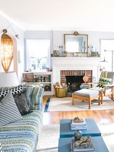 The living room furniture layout was a challenge for the couple, since the room is so long and narrow. The cozy corner near the fireplace is a favorite reading nook.