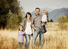 Family of 4 - very relaxed pose. Everyone looks comfortable. by herminia