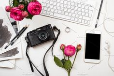 Styled flatlay with roses and phone. Business Photos