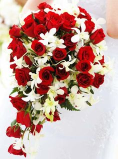 Teardrop; Red roses and white Thai orchids. Weddings in Thailand.
