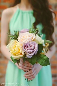 Beautiful silk rose wedding bouquet in mixed pastel colors. This soft, romantic rose bouquet in oranges, peach, pinks, mauve, purples, lavenders, yellows, and blush is perfect for your spring wedding. Paired with green leaf accents and flocked lamb's ear greenery, this bouquet just needs ribbon for a polished look!