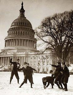 Senate page boys stage their first snow battle on the Capitol plaza. It was made in between 1909 and 1932.