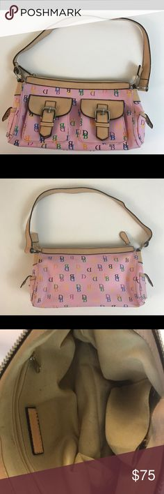 Dooney & Bourke Purse Pink Dooney & Bourke Purse Pink Around 10 inches in width  Normal wear & tear . Inside the purse has a little droppings of makeup.. Two side punches perfect for a cell phone .Little stitch coming out of one of those pouches (see photo)  No trades..... I do accept best offers :) Dooney & Bourke Accessories
