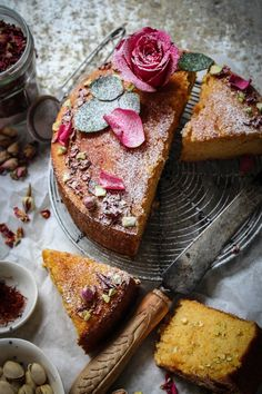 Persian Love Cake. Recipe: 1 c 250ml yogurt 1 tsp baking powder 6 eggs 1 c 220g sugar 1 1/4 c 150g ground almonds 1 c flour 150g or semolina 6 cardamom crushed 2 tbsp rosewater 6 tbsp chopped pistachios pinch saffron 100ml almond milk Lemon zest Bake 180c 350f 45 min (22cm 9 inch) pan Syrup: juice of 1 orange or lemon zest of 1 orange or lemon 1/2 c 125ml water 1/2 c 125g sugar 2 tbsp rosewater simmer until thickened brush onto warm cake
