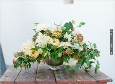 relaxed and gorgeous floral arrangement   CHECK OUT MORE IDEAS AT WEDDINGPINS.NET   #weddings #weddingflowers #flowers