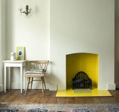 yellow tiled fireplace - lovely soft wall colour too. I love the idea of a brightly coloured fireplace and soft walls. Gorgeous floor too.