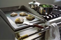 LaCanche- One of our fabulous built-in options for the cooktop. The plancha is a high-heat griddle option great for searing your fish meats.