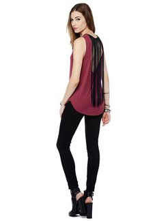 The coolest jersey knit tank with vegan leather trim, a keyhole cutout at neck, and deep scoop back with long fringe detail.