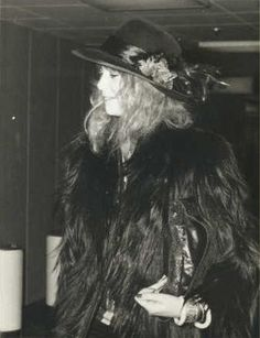 Pattie Boyd, in a magnificent monkey fur jacket and myriad accessories, mid-70's