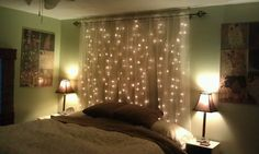 Two curtain rods, two strands of lights n sheer curtains. Used fishing line n clear tape to make lights evenly distributed.