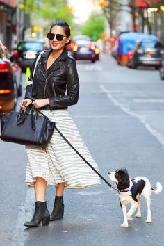 Trusty moto jacket + billowy skirt + boots = not even your puppy can stop looking at you admiringly.   - MarieClaire.com