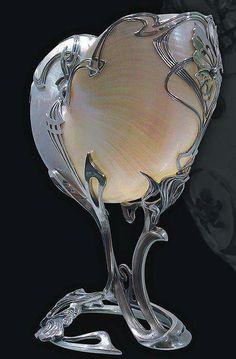 Art Nouveau nautilus shell in silver.