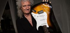 Guitarra assinada por Queen + Adam Lambert angaria 9 mil euros