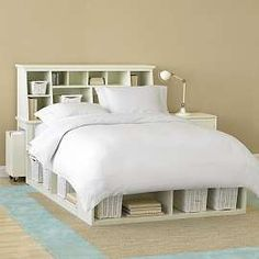 We have no space for end tables, so this storage behind the bed would be great.