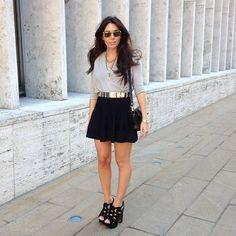 Natacha Steven wearing her Carrera by Jimmy Choo sunglasses at NYFW