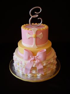 Girl Christening - 6. 8, 10 in. tiers iced in BC.  Technique for smoothing BC learned from Sugarshack's buttercream DVD, I highly recommend all of her DVD's!  Decorations are MMF.  Thank you to cake_architect for the tutorial for the billowing technique, I love doing it!  Topper was bought from Party City.