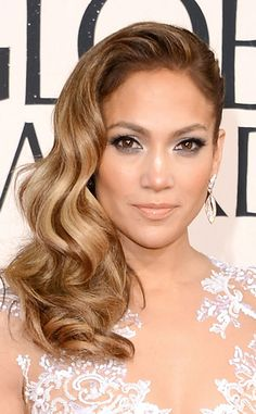 Jennifer Lopez glowed on the red carpet with romantic sideswept waves and radiant makeup.